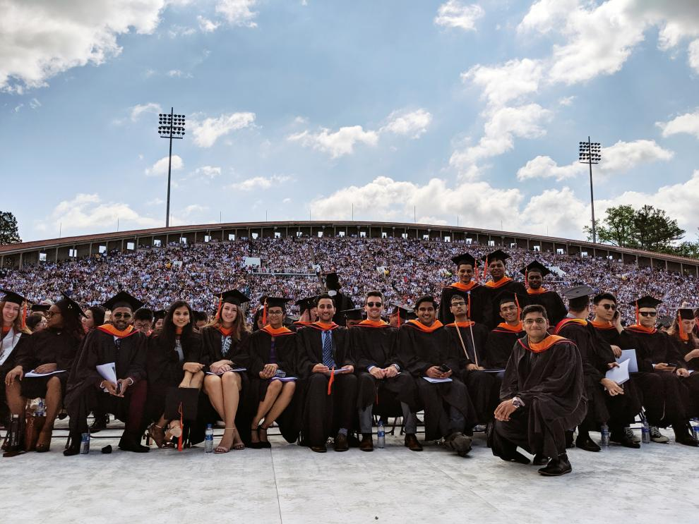 students sitting in the stadium during commencement